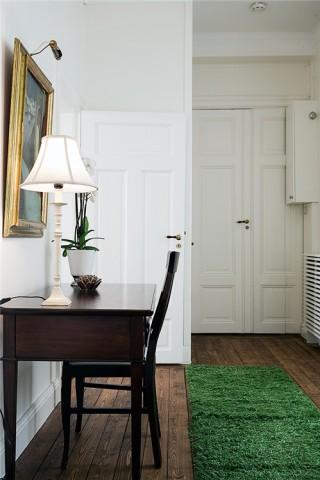 wooden floor, green carpet